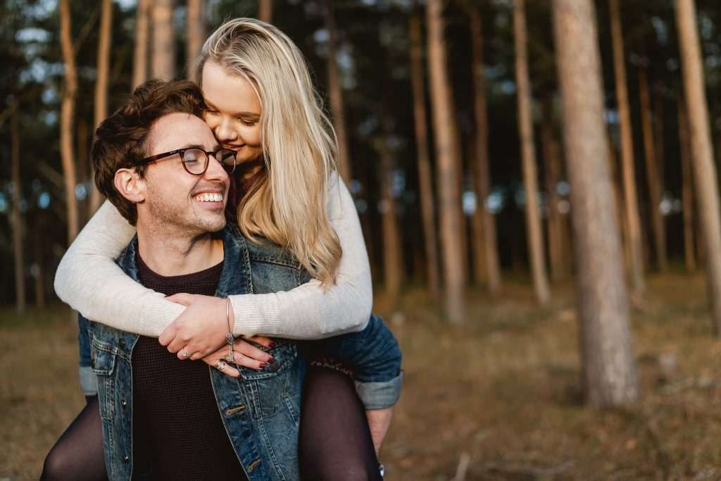 Couple embrace during engagement shoot in the Midlands with Sam and Louise Photography