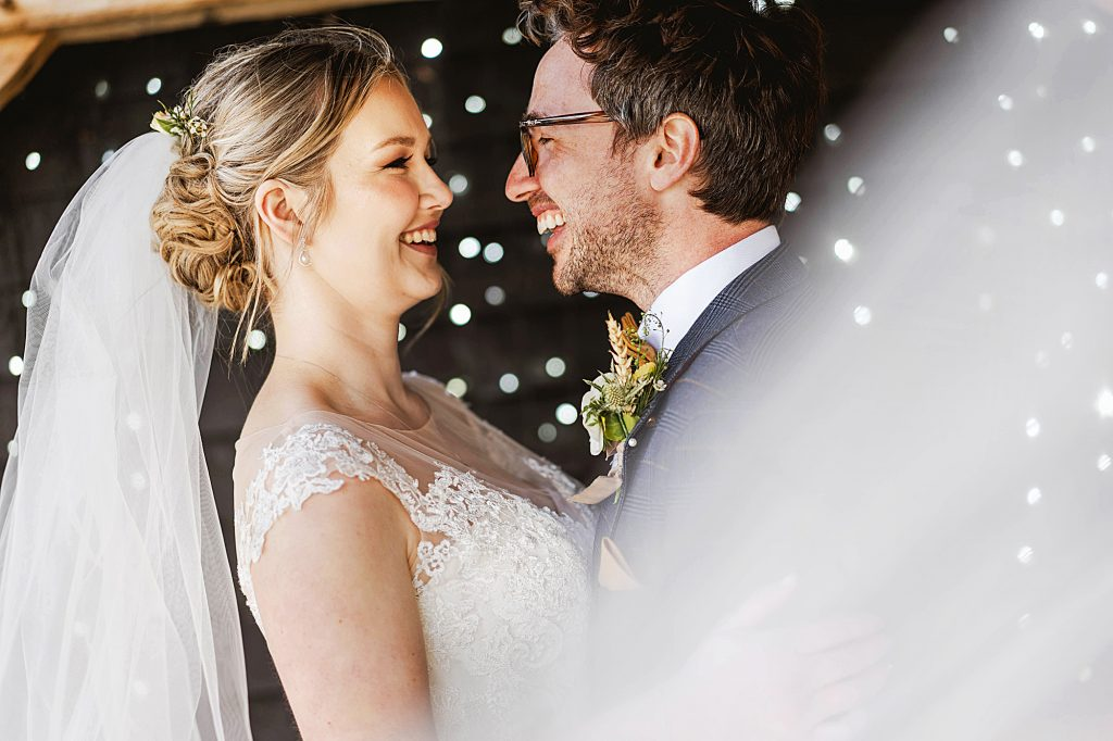 midlands wedding photographers photograph bride and groom at winters barns