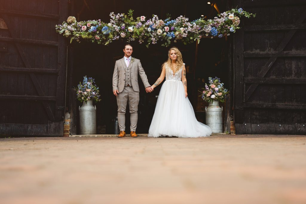 bride and groom pose for Staffordshire wedding photographers