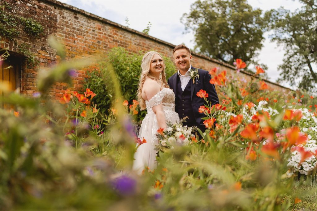 couple pose at their Barn wedding by staffordshire wedding photographers